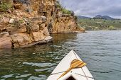 image of horsetooth reservoir  - canoe and sandstone cliff  - JPG