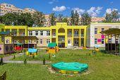 stock photo of nursery school child  - children playground in the play school yard - JPG