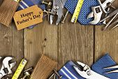 stock photo of tied  - Happy Fathers Day gift tag with double border of tools and ties on a rustic wood background - JPG