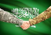 image of saudi arabia  - Soldiers shaking hands with flag on background  - JPG