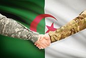 image of algeria  - Soldiers shaking hands with flag on background  - JPG