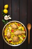 stock photo of pea  - Chicken paella a traditional Valencian  - JPG