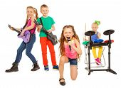 image of girl toy  - Group of kids playing on musical instruments together and girl singing as vocalist in front on white background - JPG