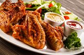 stock photo of chicken wings  - Grilled chicken wings and vegetables  - JPG