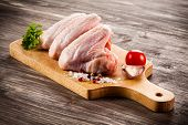 picture of chicken wings  - Raw chicken wings on cutting board  - JPG