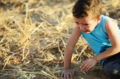 picture of muslim kids  - Kid crying on field - JPG