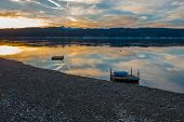 stock photo of olympic mountains  - A brilliant sunset is reflected in the waters of Hood Canal in Washington State - JPG
