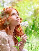 image of dandelion  - Portrait of nice dreamy woman on fresh green field with dandelion flower bouquet - JPG