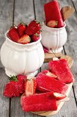 stock photo of strawberry plant  - Strawberry homemade ice pops  - JPG