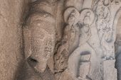 pic of stone sculpture  - stone Kwan Yin sculpture in the cave - JPG