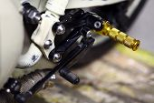 pic of gear-shifter  - Color detail with the gear shifter of a motorcycle - JPG