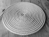 image of coil  - Rope Coil on wooden desc - JPG