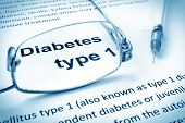 stock photo of diabetes mellitus  - Paper with words diabetes type 1 and glasses - JPG