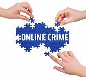 image of crime solving  - Hands with puzzle making ONLINE CRIME word isolated on white - JPG