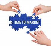 stock photo of time-piece  - Hands with puzzle making TIME TO MARKET word isolated on white - JPG