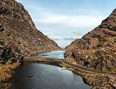 stock photo of gap  - Irish landscape with lake and road - JPG