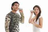image of tin can phone  - boy and girl are talking on selfmade phones - JPG