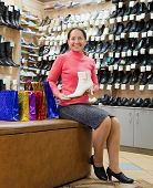 Woman Shopping At  Shoe Store