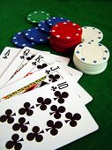stock photo of poker hand  - photo of playing cards and poker chips - JPG