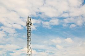 pic of antenna  - Telecommunication antenna on blue sky with clouds background - JPG