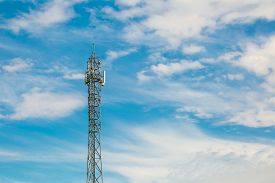 foto of antenna  - Telecommunication antenna on blue sky with clouds background - JPG