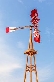 picture of wind vanes  - The multicolor wind vane againsts beautiful clear blue sky - JPG