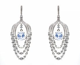 stock photo of lapis lazuli  - earrings with blue stones on the white background - JPG