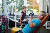 Female Senior Working Out With Dumbbells