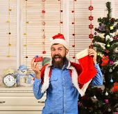 Santa Claus With Cheerful Face Near Christmas Tree poster