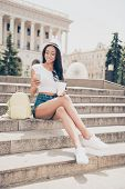 Attractive Carefree Gorgeous Mixed-race Lady With Bronze Skin Is On Stroll, In Jeans Short Shorts, S poster