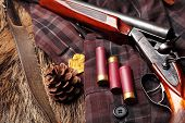Hunting Double Barrel Vintage Shotgun, Cartridge Case On The On The Hunters Jacket In Cell, Close-up poster