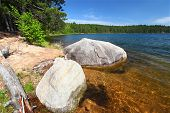 stock photo of legion  - Huge boulder along the shoreline of Buffalo Lake in the Northern Highland - JPG