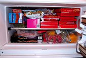 stock photo of frozen food  - a freezer full of frozen food and treats - JPG
