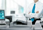 Businessman and printer in office