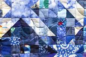Patchwork Squares On Blue Quilt