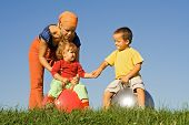 Family Outdoors Playing Together poster