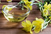 Evening Primrose Oil With Evening Primrose Flowers poster