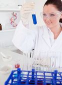 Attractive Red-haired Woman Holding A Test Tube