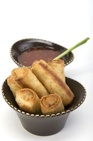 picture of lumpia  - Egg rolls and sweet and sour sauce in a ceramic bowl - JPG