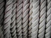 Close-up Of An Old Frayed Boat Rope As Background, Spiral Of Rope, Coiled Rope On Boats Deck. poster