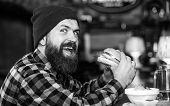 Hipster Hungry Man Eat Burger. Man With Beard Eat Burger Menu. Brutal Hipster Bearded Man Sit At Bar poster
