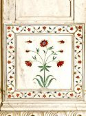 stock photo of khas  - Detail inlaid flowers on marble column Hall of Private Audience or Diwan I Khas at the Lal Qila or Red Fort in Delhi India - JPG