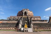 Pagoda And Buddha Statue At Wat Chedi Luang Temple In Chiang Mai Thailand poster
