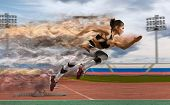 Woman sprinter leaving starting blocks on the athletic track. Exploding start poster