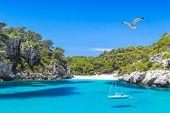 Cala Macarelleta Beach with Turquoise Water of Mediterranean Sea. Menorca Island Travel Background. poster