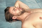 Lazy Morning. Awake For Morning Routine. Single Man After Waking Up In Morning. Sexy Man Lying In Be poster
