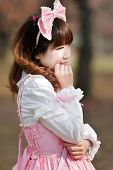 japanese in sweet lolita cosplay outdoor portrait