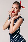 Portrait Of Surprised Pin Up Woman In Polka Dot Dress. Cute Girl In Retro Style poster
