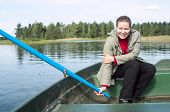 Happy Caucasian Woman In Row Boat Holding Paddle