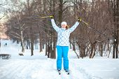 picture of nordic skiing  - Woman sportsman on cross ski with ski - JPG